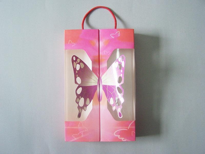 >蝶状手提包装